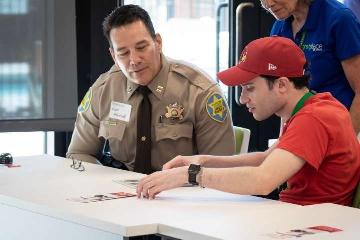 Matt works with a deputy from the Maricopa County Sheriff's Office, one of several who recently visited First Place–Phoenix and joined residents for group and one-one-one safety training sessions. Together, they learned about their shared responsibilities and through role-playing practiced what they need to do to stay safe in a variety of community situations.