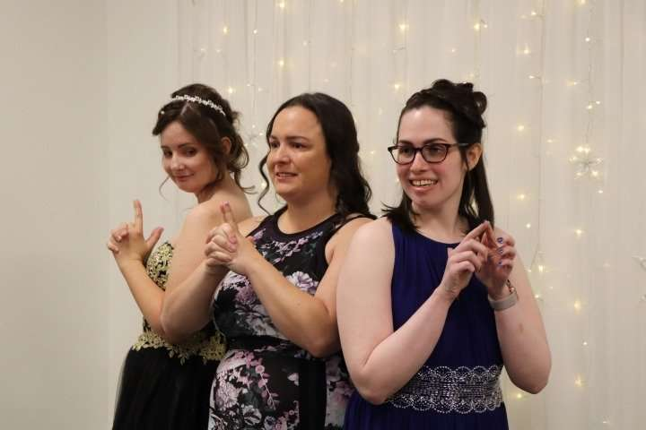 Christy (left) and her friends strike the iconic Charlie's Angels pose before heading out to their first Night to Shine Prom last spring. The group often attended community life activities together and gathered in each other's apartments.