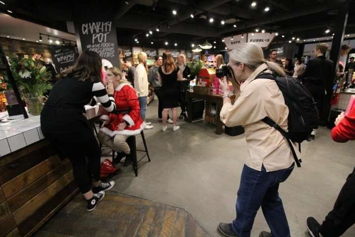 Lauren tries a beauty mask at the Lush store counter during a group outing to Fashion Square Mall in Scottsdale. Lynn documented the residents' interactions as they shopped for holiday gifts and spent quality time together.